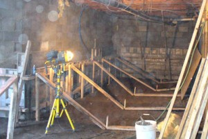 Shoring up walls and forms for underpinning a foundation.