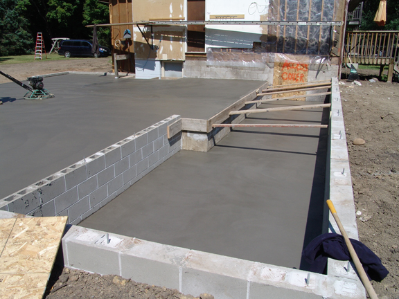 It was a good day to pour concrete! Here you can see the soon-to-be crawl space area on the right. The pour went exceptionally well and the great weather ...