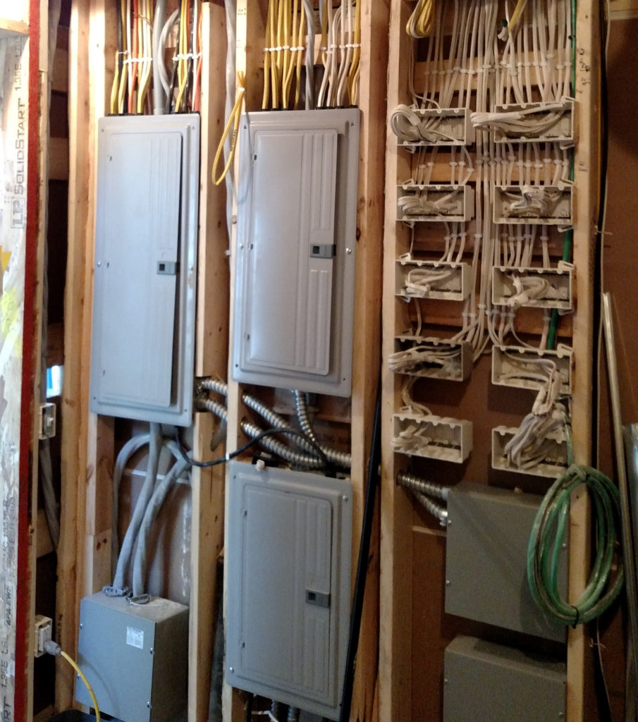 Organized elaborate switch and wiring rough-in for high-tech electronics in home.
