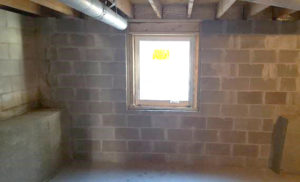 Egress window in unfinished but brand new basement.