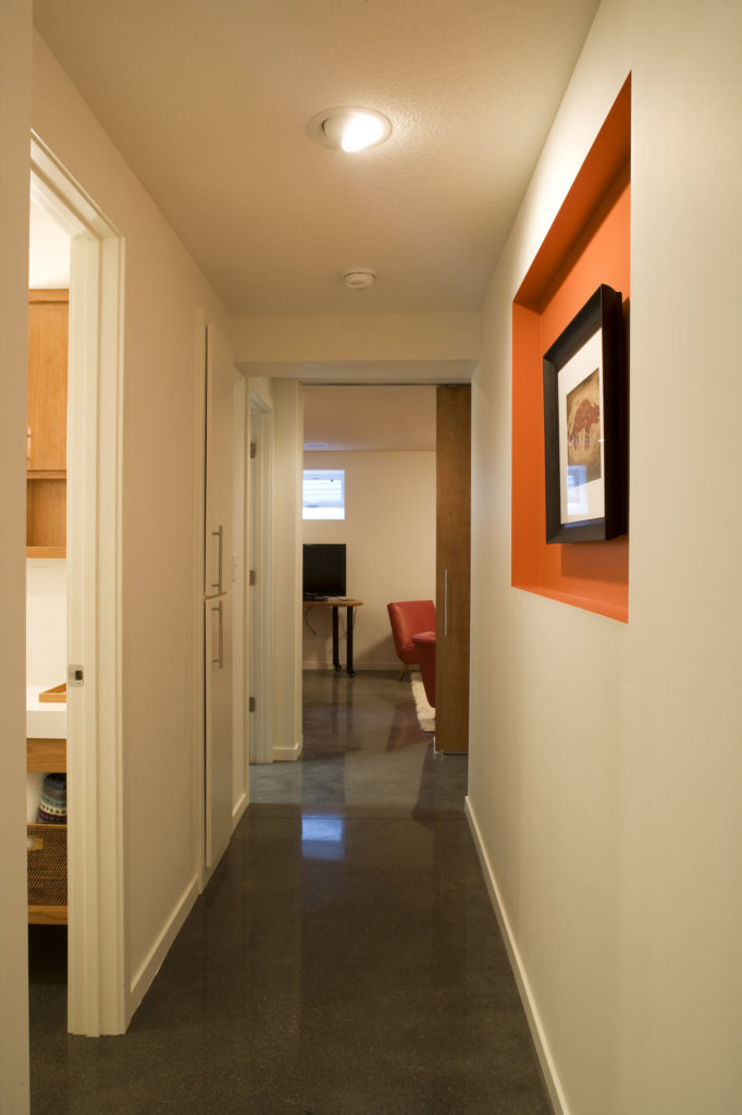 Hallway in finished basement after an underpin of the foundation to create a finished basement.